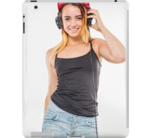 Playful female teen with headphones and red baseball cap wearing black top  iPad Case/Skin