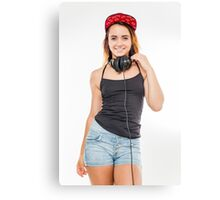 Playful female teen with headphones and red baseball cap wearing black top  Canvas Print