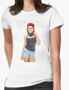 Playful female teen with headphones and red baseball cap wearing black top  Womens Fitted T-Shirt