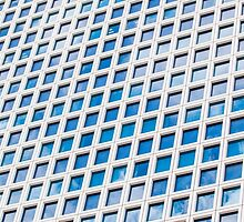 Windows of an office building form a pattern  by PhotoStock-Isra