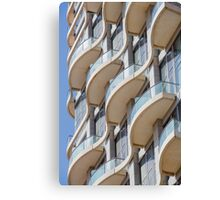 Balconies on a residential building form a repetitive pattern  Canvas Print