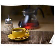 Tea in yellow cup on table Poster