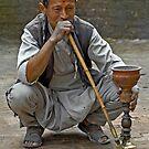 Smoking the hookah by Konstantinos Arvanitopoulos