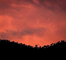 Blood Clouds on the Hills by Dane Strom