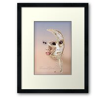 The mask of many moons Framed Print