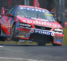 Craig Lowndes does it on two wheels by Dean Perkins