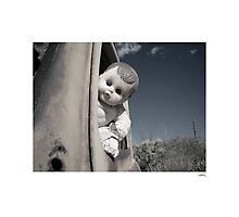 Doll at the wheel Photographic Print