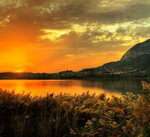 Sunset over the lake by Roberto Pagani
