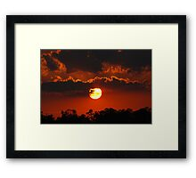 A Nearly Full Sun Sunset Framed Print
