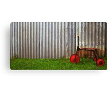 Red trike reminiscing of simpler times... Canvas Print