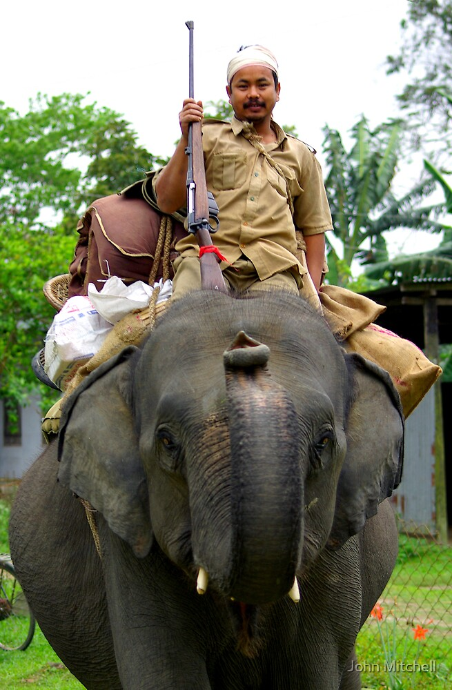 Assamese game warden setting out on a one week patrol. by John Mitchell