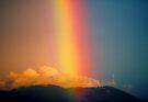 Rainbow over Mount Dandenong, Victoria, Australia. by Ern Mainka
