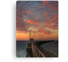 Evening Walk Along the Jetty Canvas Print