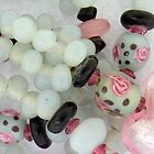 pale blue momi with black spots and roses by poshbeads