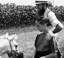 Amish Girl and Father at Auction by schiabor