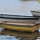 Small boats at Lyme harbour, Dorset UK by lynn carter