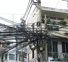 Tangled powerlines in Saigon by simoneandginko