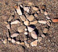 Mandala on the beach by Gudrun Eckleben