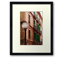 Building with green shutters... Framed Print