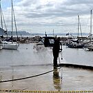 Cleaning up the Slipway at Lyme Dorset UK by lynn carter