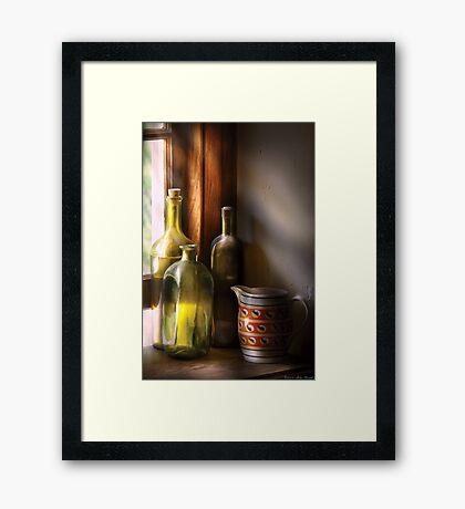 Three bottles Framed Print
