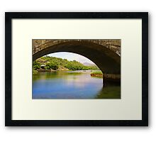 Water through the bridge Framed Print