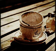 Dirty coffee cups in sepia with texture by Elana Bailey