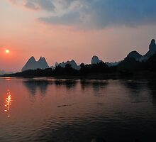 Li River Cruise & The Harst Mountain Range. Yangshuo, China. by Ralph de Zilva