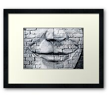 Graffiti smile on the textured brick wall Framed Print