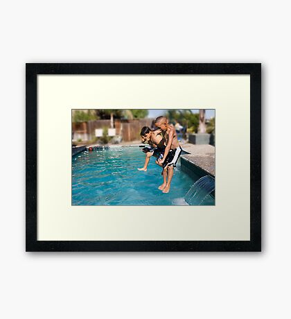 Boys having fun in the summer Framed Print