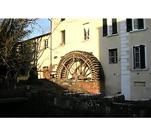 Rusted wheel of the mill  Photographic Print