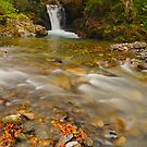 waterfall over riberot river by patrick pichard