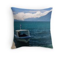 Boat on the lac Throw Pillow