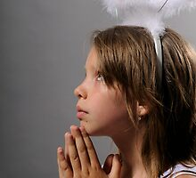 girl praying by fotomagique