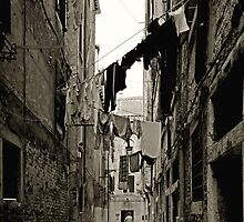 Hanging laundry in an alley in Venice by sumners