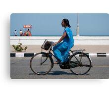 Cyclist in a blue sari. Canvas Print