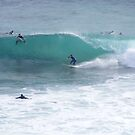 Bottom turn, carve to stall, line up, race the barrell, what do you think? by gamo