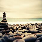 Rock Balancing on the Nice Promenade by cormacphelan