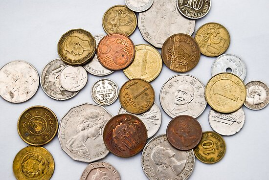 Coins of different countries on white by yurix