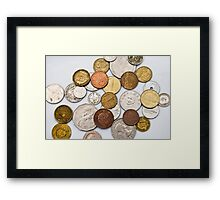 Coins of different countries on white Framed Print