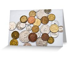 Coins of different countries on white Greeting Card