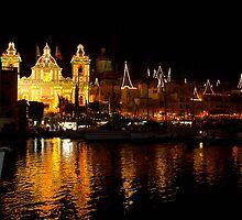 Church of San Lawrenz with Birgu lit up behind. Malta by DeborahDinah