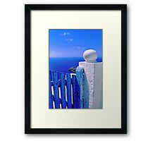 Greek blue gate with wandering clouds Framed Print
