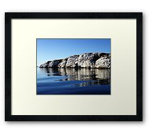 A Rock in the Ocean Framed Print