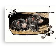 Baby devils in the den Canvas Print