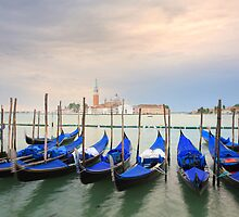 Gondolas at sunrise by Christophe Testi