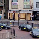 Taxis on the High Street by cate murray