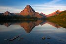 Sinopah Mountain reflected in Two Medicine Lake at Sunrise. Glacier National Park. Montana. USA. by PhotosEcosse