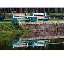 Bench at waters edge Photographic Print