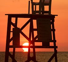 Empty Lifeguard chair at sunset by kinz4photo